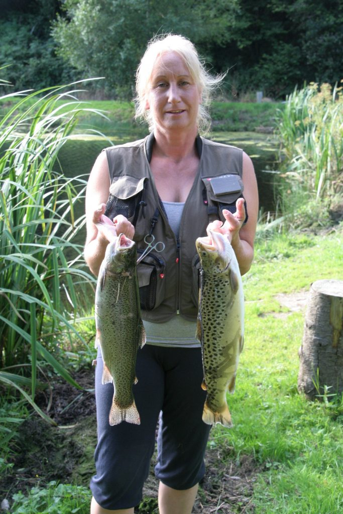 Debbie Tucker with brace of Bratton Trout including a 3lb 1oz brown trout