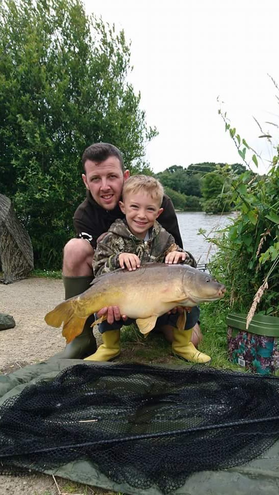 Craig Batti and son Cayden fishing on Beattie's lake on the summer house swim using WLM baits. With  just one of his many catches.